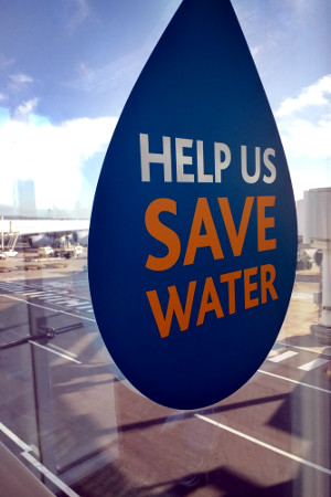 Sign at Cape Town airport: 'Help us save water'